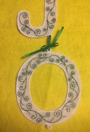 Letter O with scroll work.